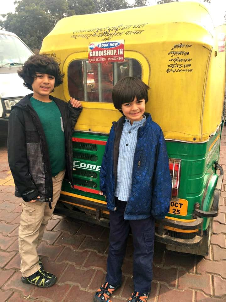 My sons, Alexander and Veer, about to ride an auto rickshaw, known locally as a tuk-tuk in India with children