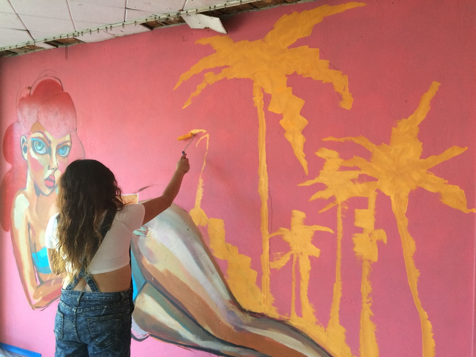 Artist Diana Contreras painting a mural in Fort Lauderdale