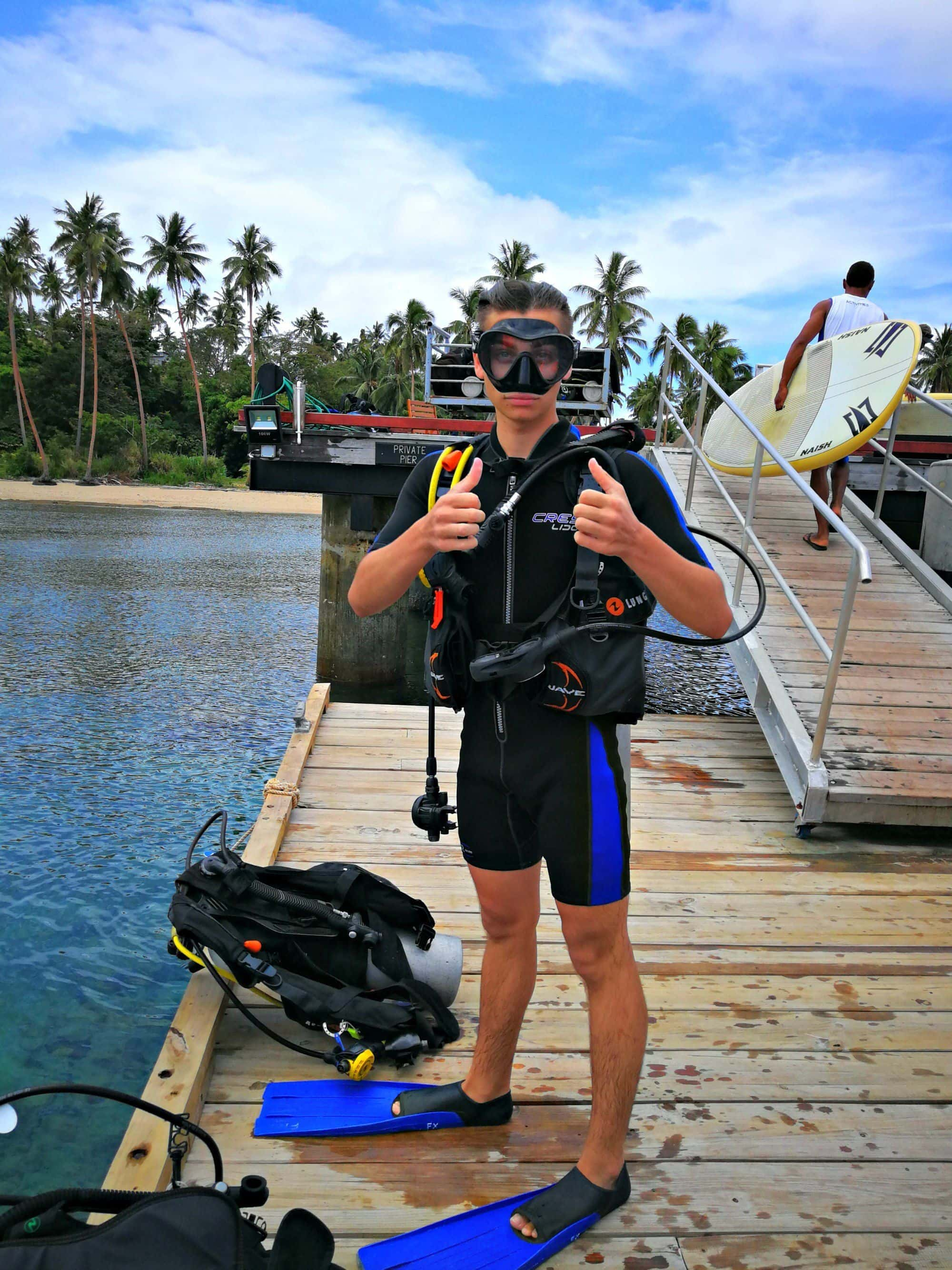 Learning the art and science of scuba diving at Cousteau Dive Centre in Fiji with kids