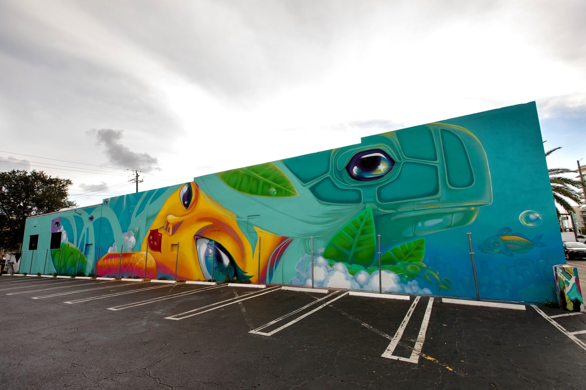 Mural by Yuhmi Collective in Hollywood, Florida