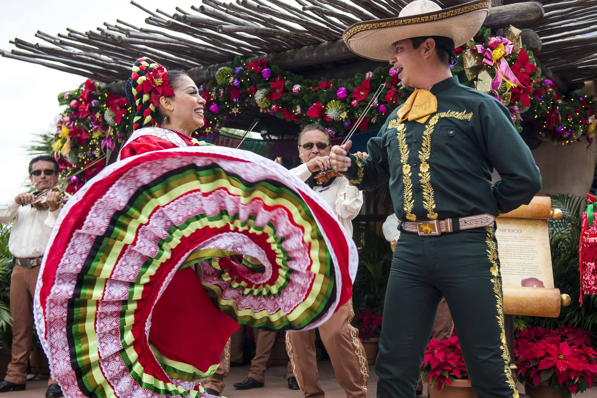 Festive mariachi band music and dancing at the Mexico pavilion at Epcot with kids for Holidays Around the World