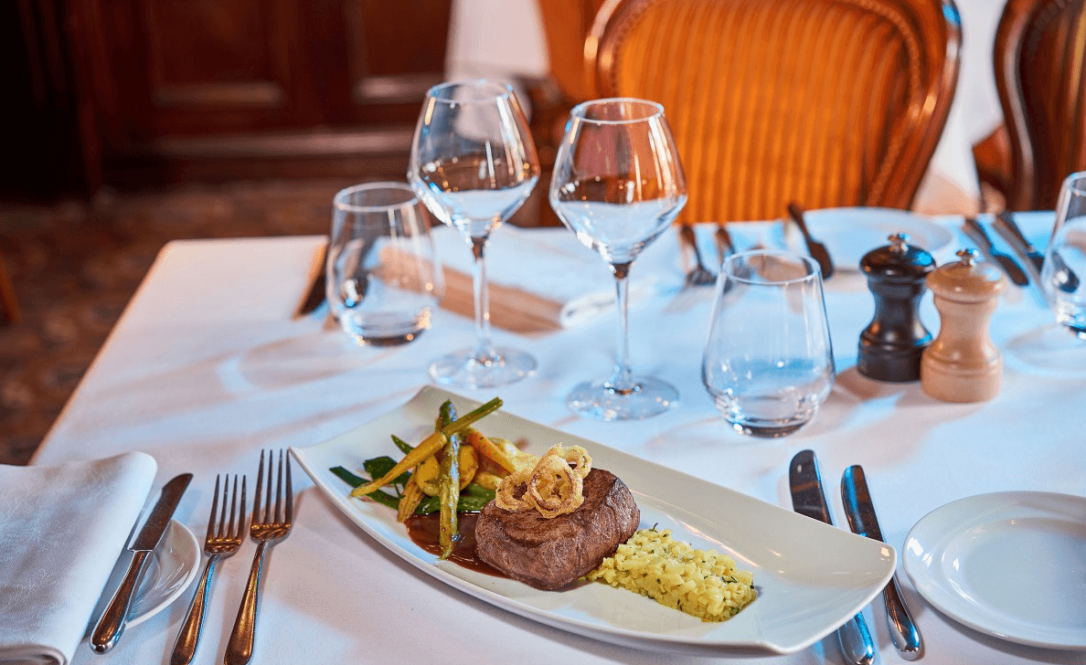 For an upscale taste of home, book a meal at Walt's - An American Restaurant at Disneyland Paris with kids