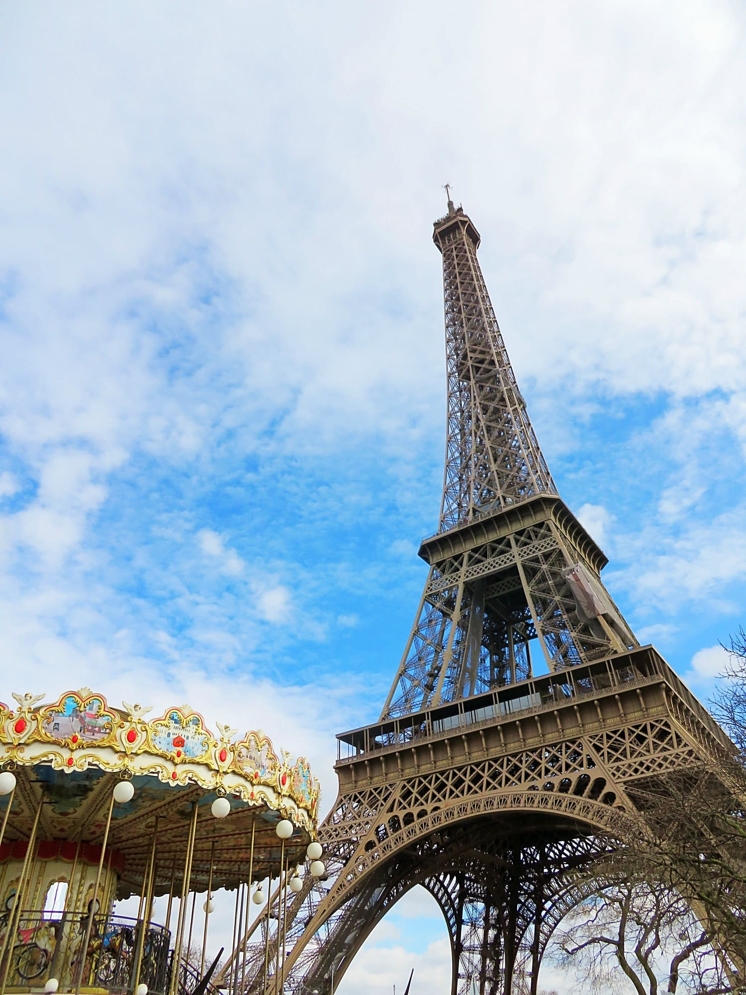 Eiffel Tower and carousel in Paris with kids