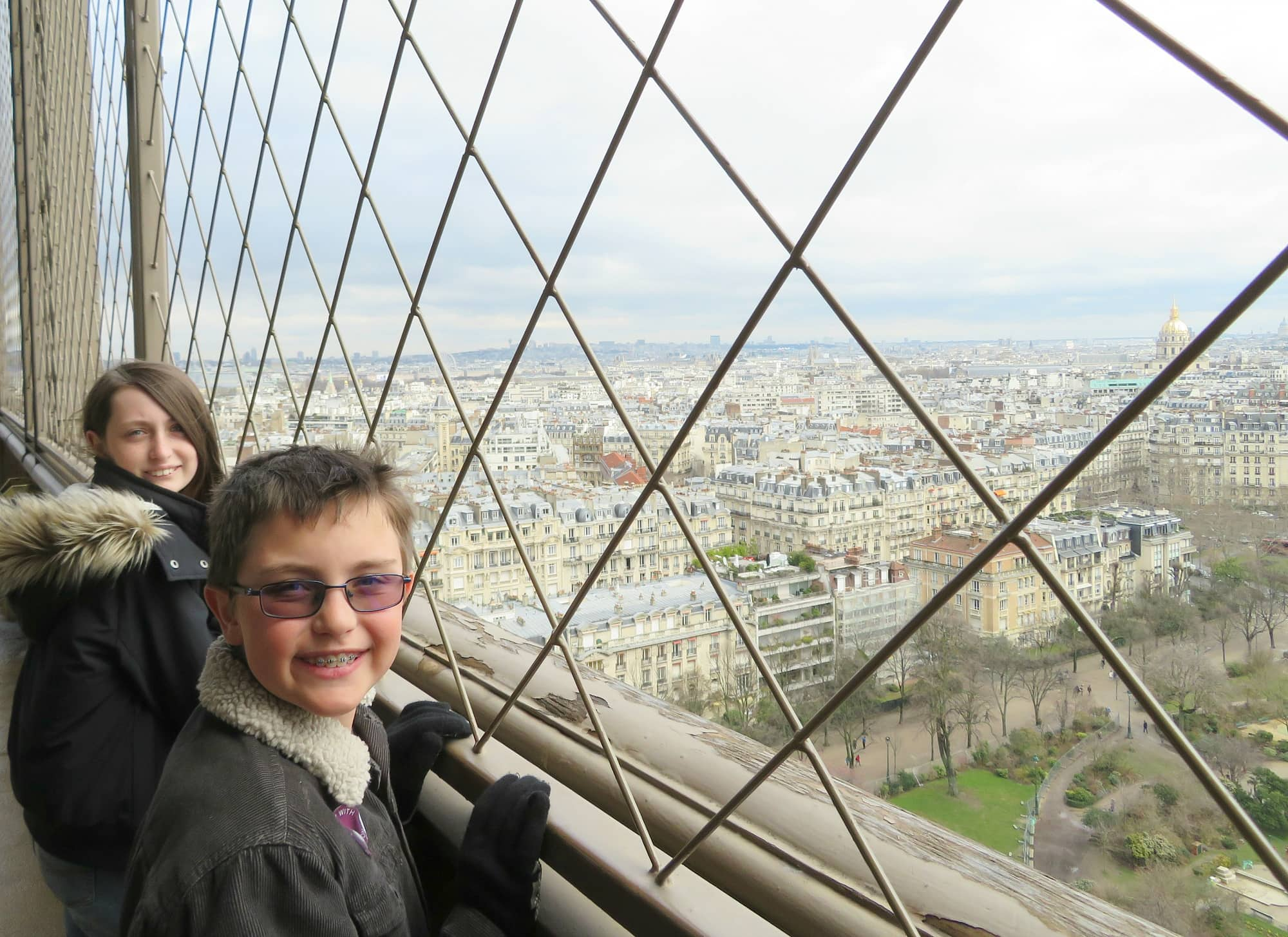 View of Paris from the second level of the Eiffel Tower in Paris with kids