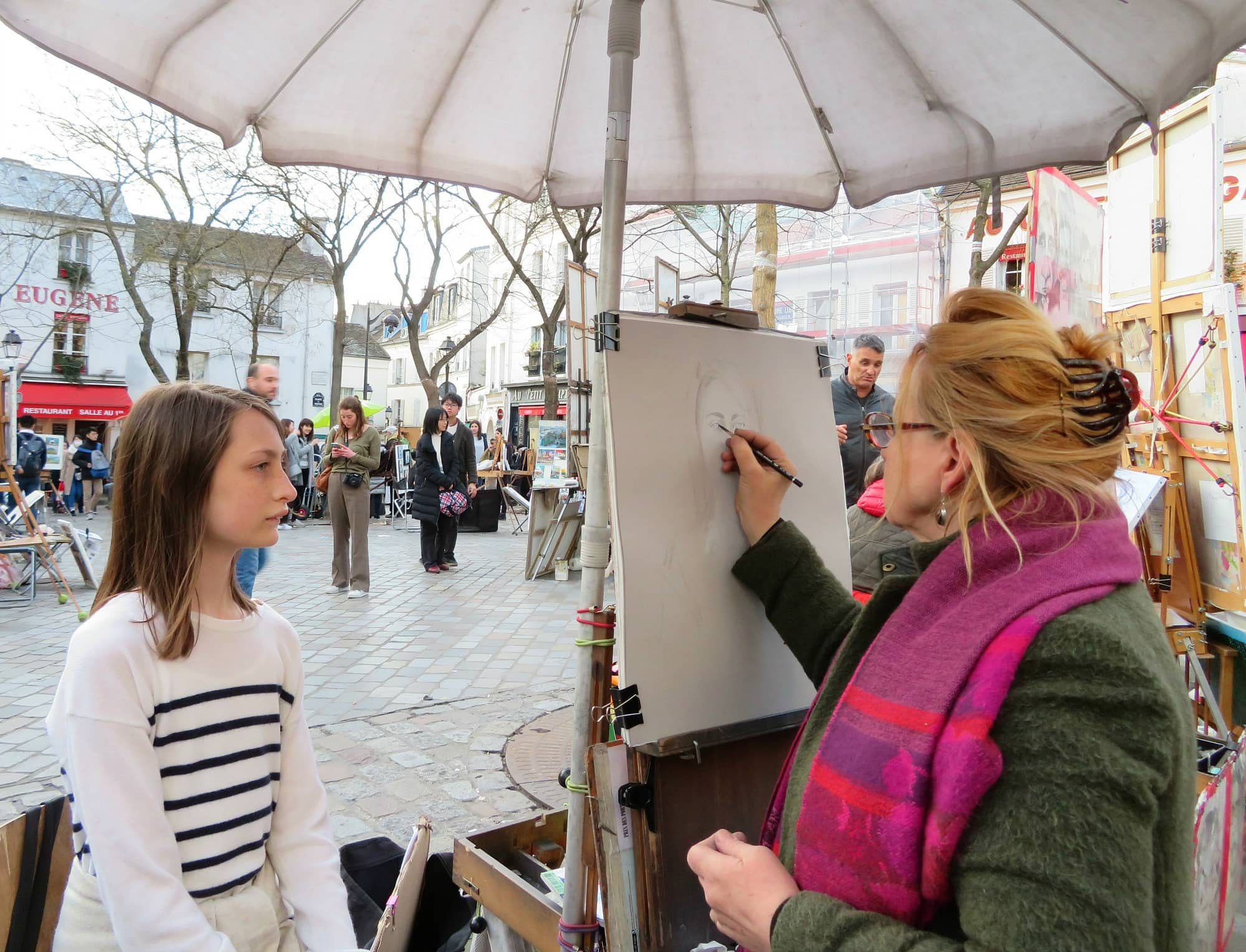 My daughter getting her portrait drawn in Montmartre