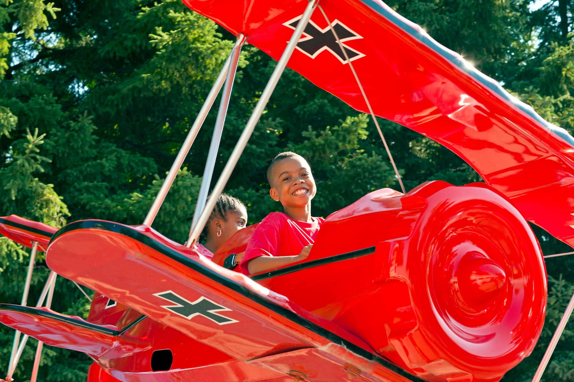 Kids fly in Snoopy vs. Red Baron in Planet Snoopy