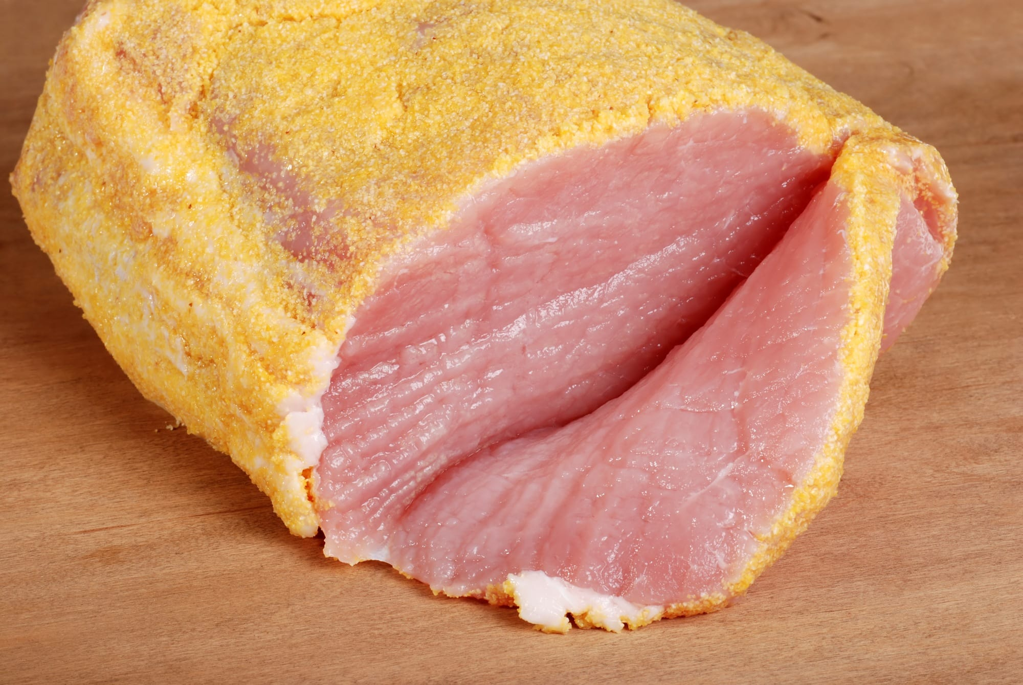 "Peameal bacon, the brined version of ""Canadian bacon"""