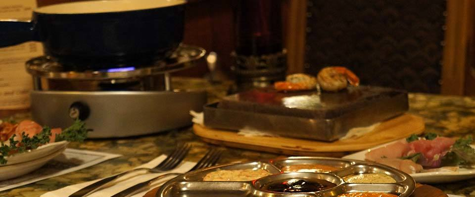 A fondue dinner at Grizzly House make a memorable meal in Banff with kids