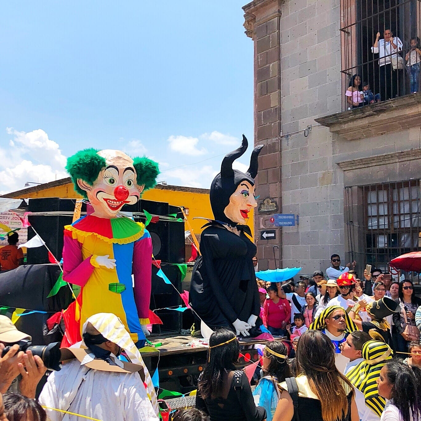 "A ""float"" in the Dia de los Locos parade in San Miguel de Allende with kids"