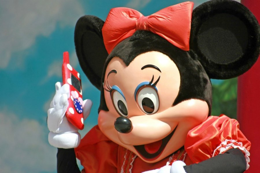 Minnie Mouse know how important it is to keep your smart phone charged at Disneyland!
