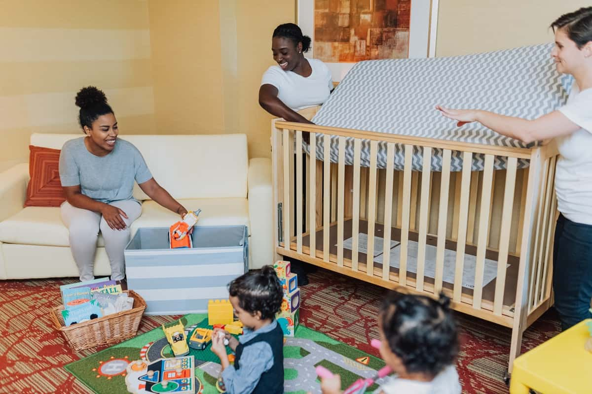 A full-sized crib and other baby equipment helps families enjoy their travels more
