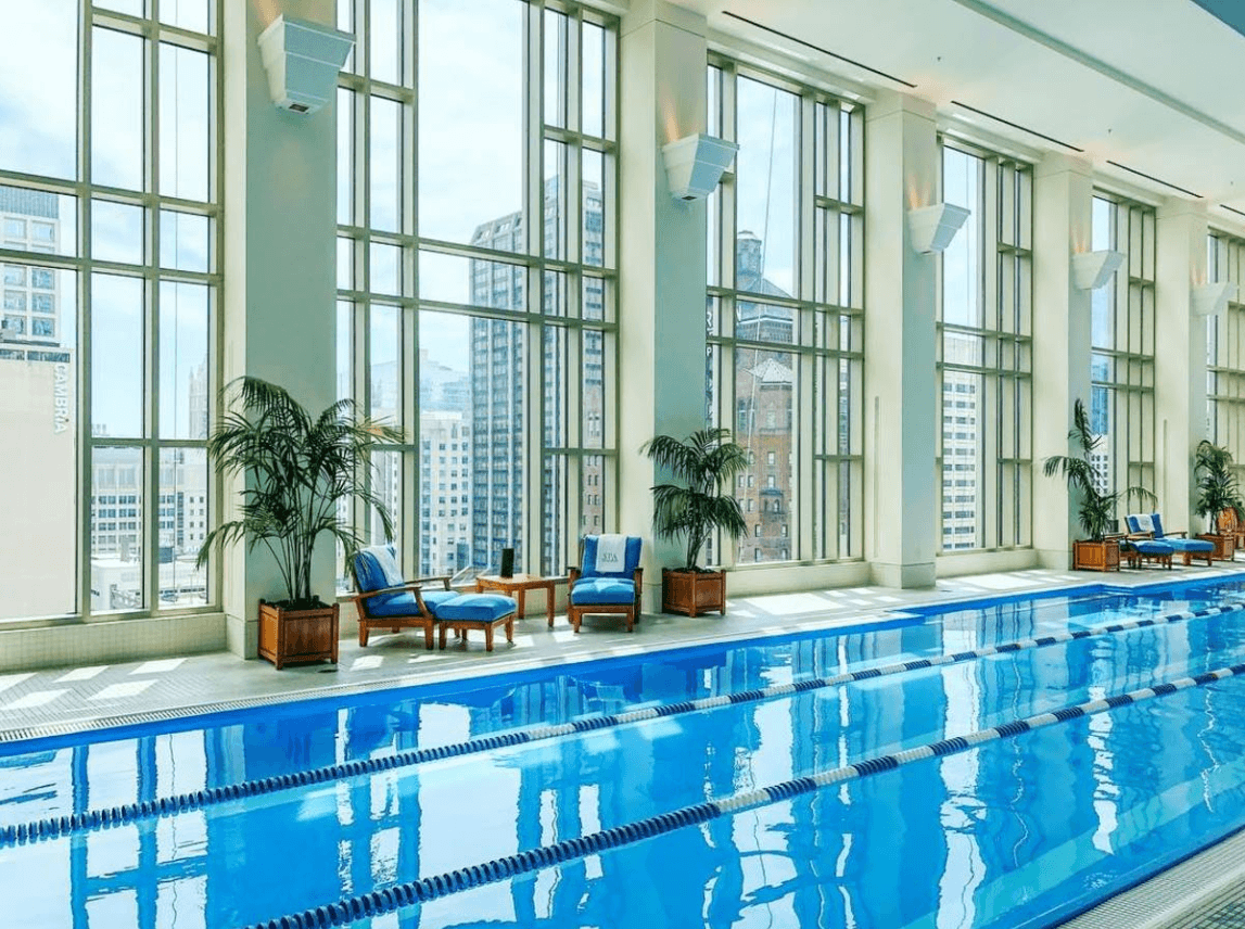 The Peninsula Chicago's indoor pool with a view of the Windy City ~ Best Indoor Hotel Pools