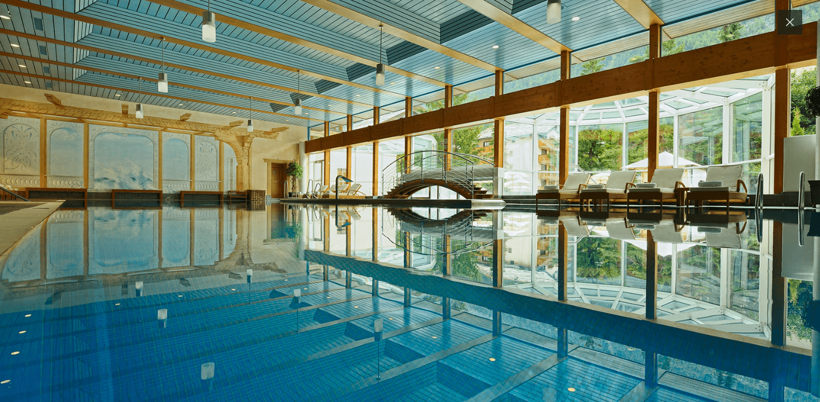 Indoor-outdoor pool at Hotel Mont Cervin Palace in Zermatt, Switzerland ~ Best Indoor Hotel Pools for Kids