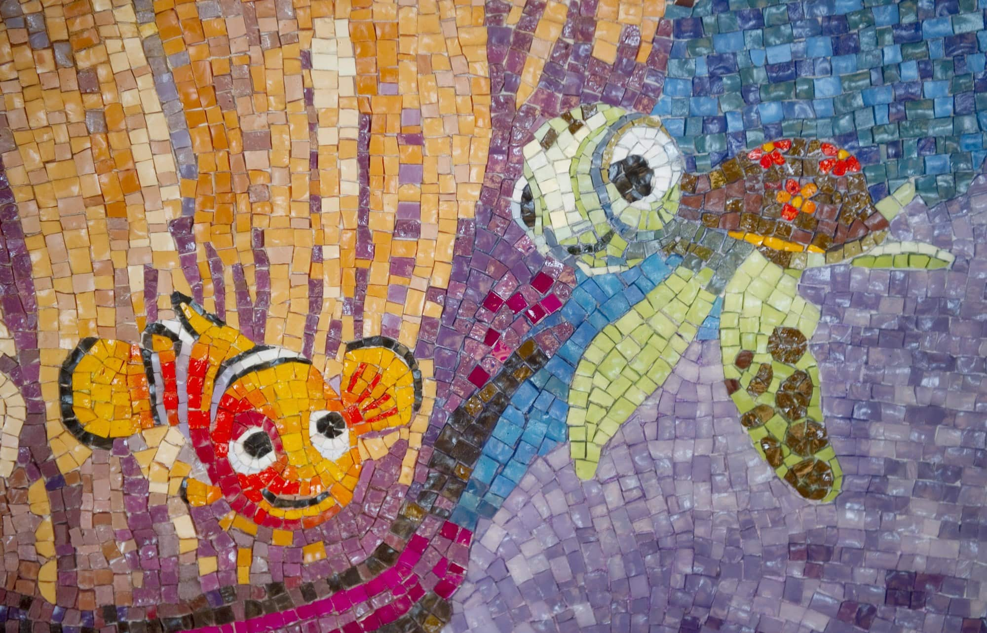 A Finding Nemo-themed mosaic adds to the beach theme at Cabanas on Disney Dream with babies, toddlers and children