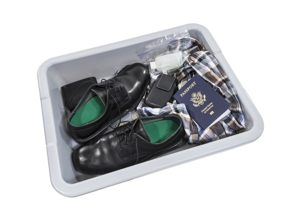 Adults must remove shoes during airport security but kids under 12 can keep them on
