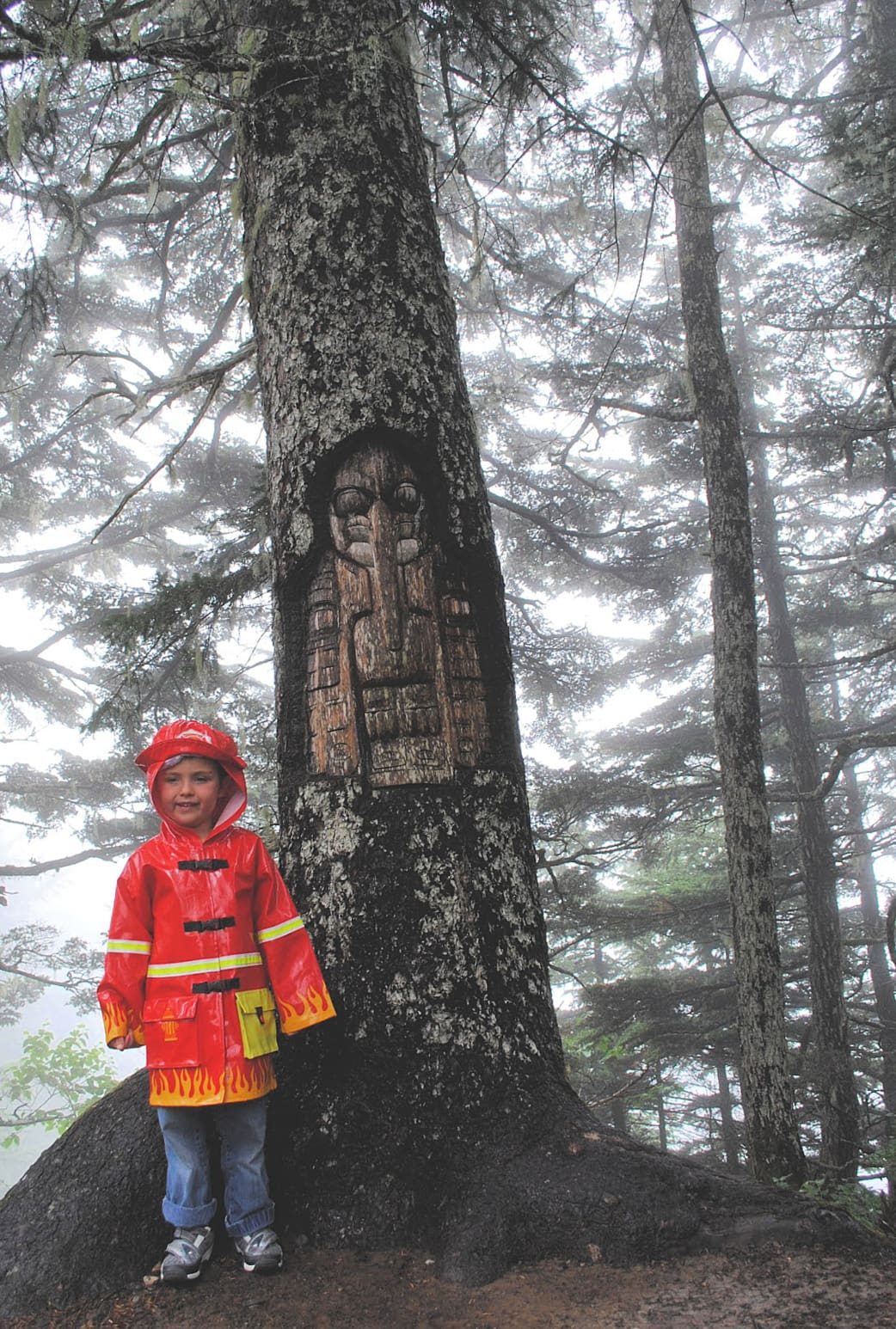A living tree carving on Mount Roberts in Juneau, Alaska with kids
