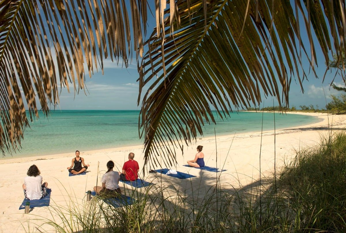 Adults can take a yoga class at Serenity Bay on Castaway Cay