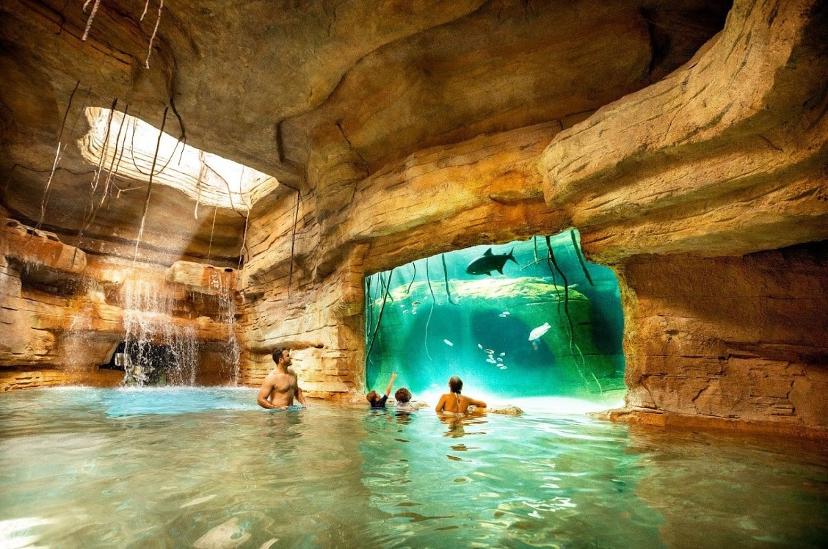 The Abyss waterslide drops riders into a cenote at Atlantis Bahamas