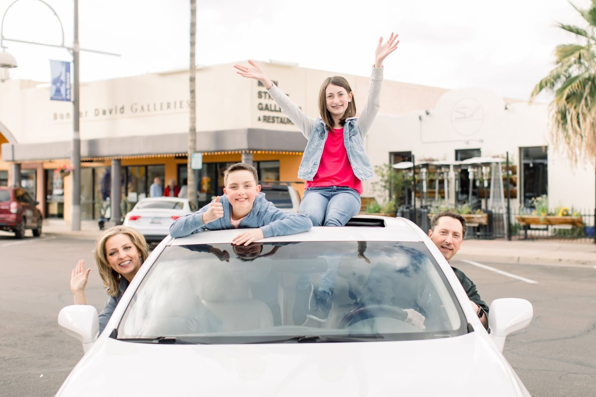 family travel blogger car
