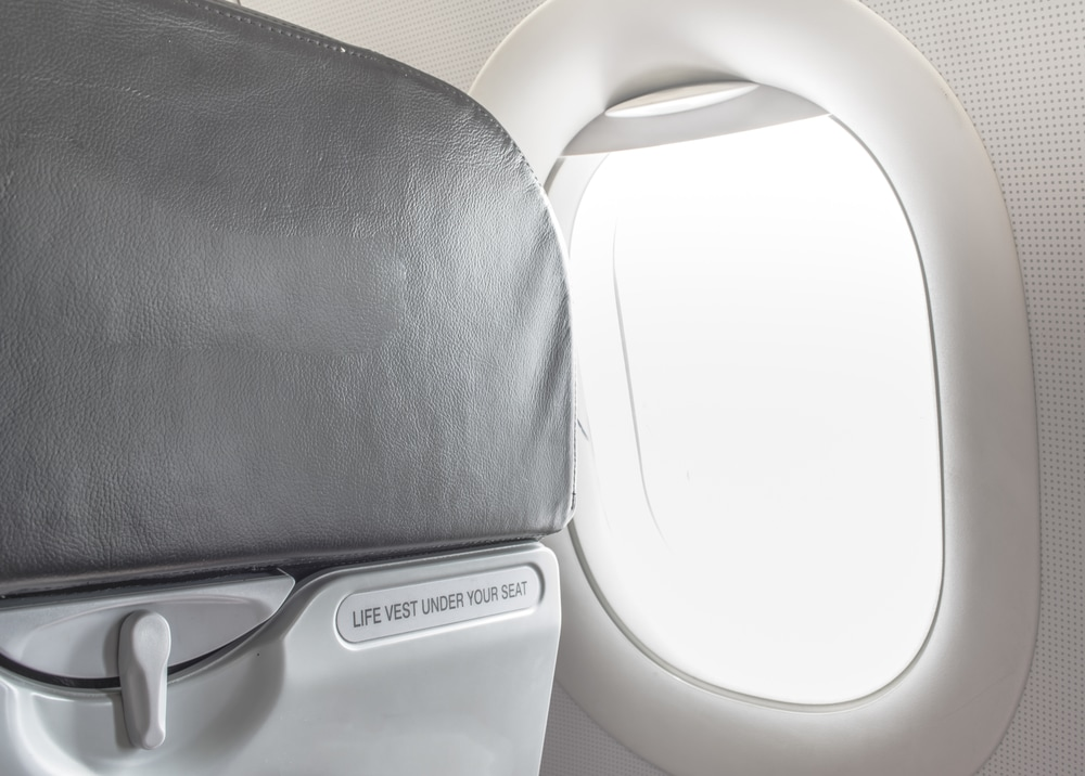 Use antibacterial wipes to disinfect germ-ridden surfaces during your travels, like airplane tray tables