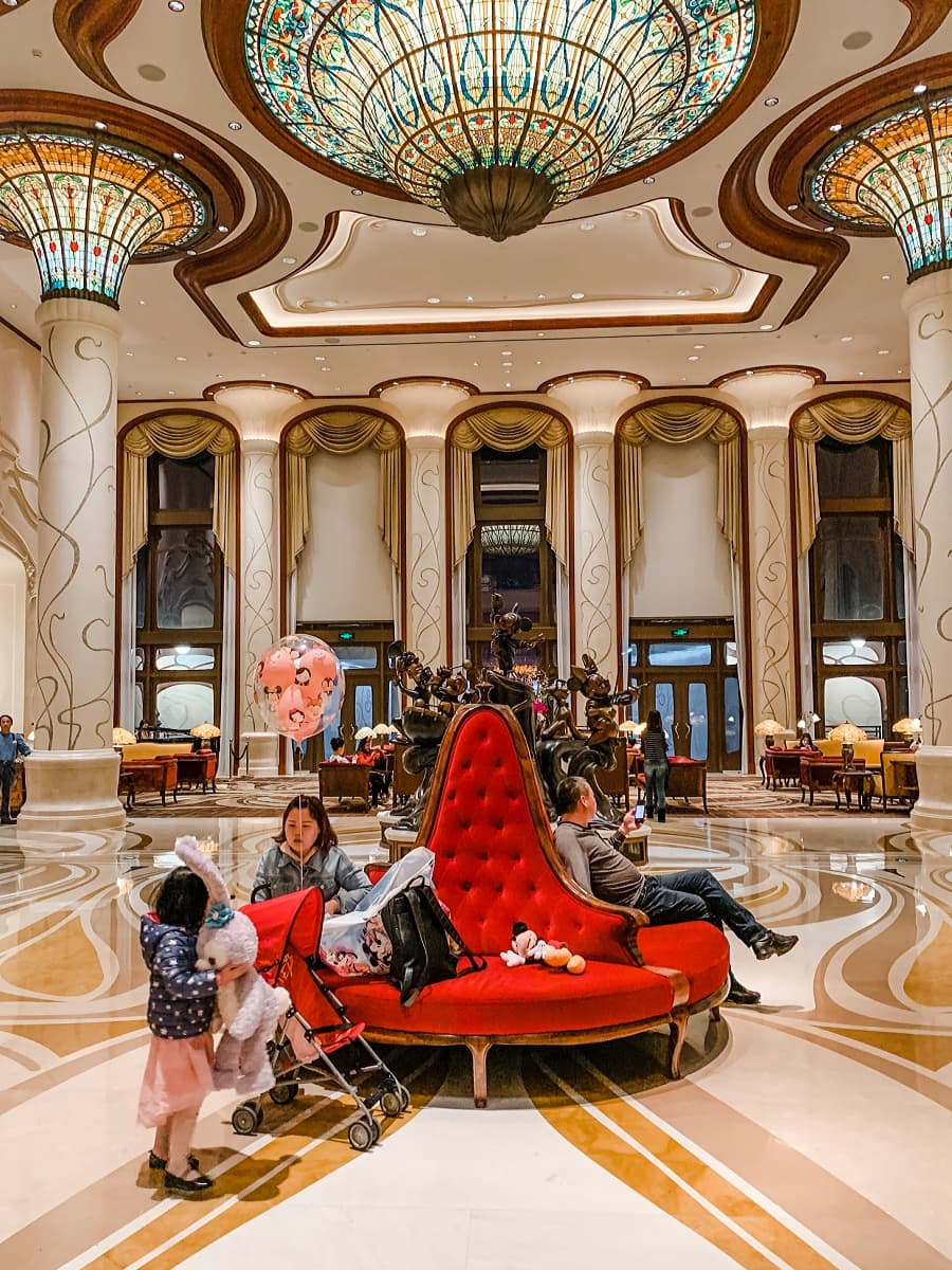 The luxurious lobby at Shanghai Disneyland Hotel with kids