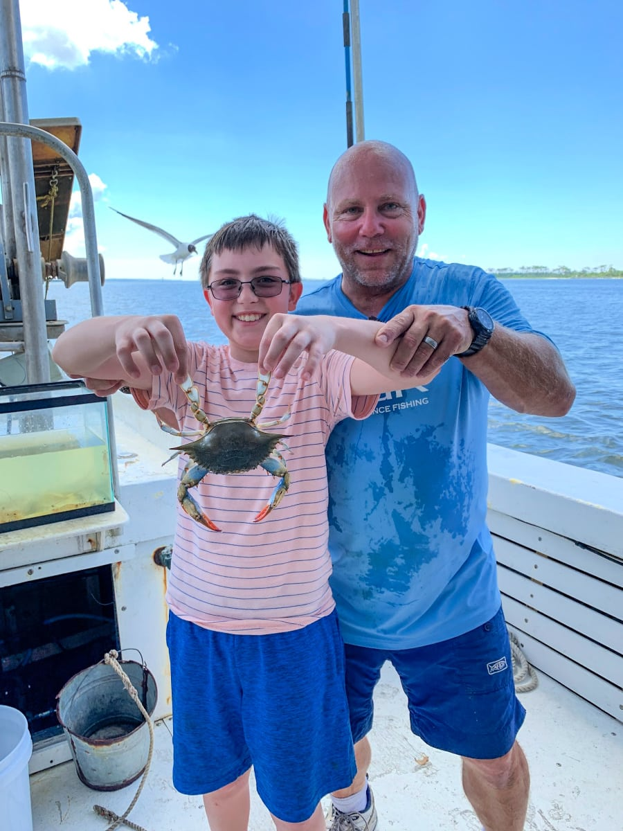 A freshly caught blue crab on the Biloxi Shrimping Trip in Mississippi Gulf Coast with kids