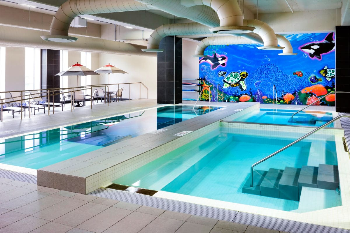 The Glass-bottom pool at the Le Westin Montréal is one of the best hotel pools in Canada for families