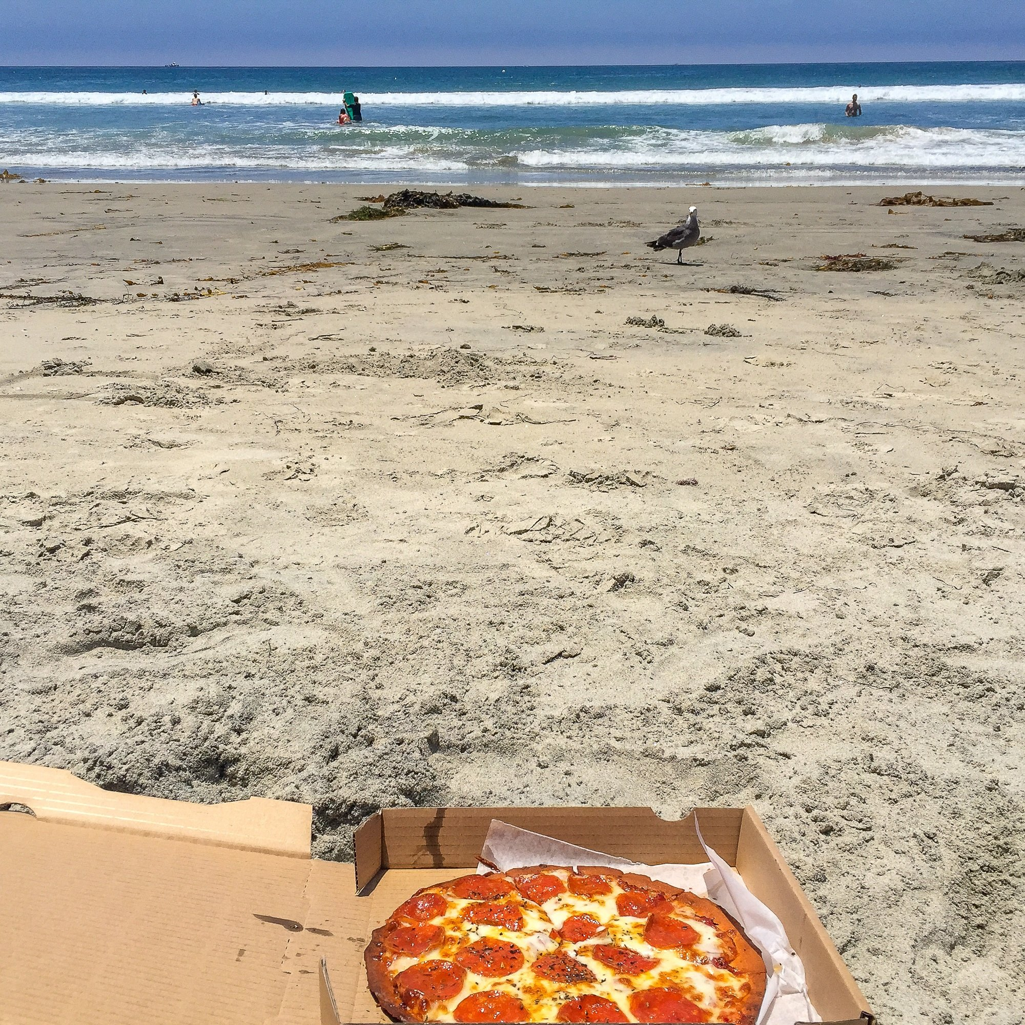 Pizza Port pepperoni pie on the beach