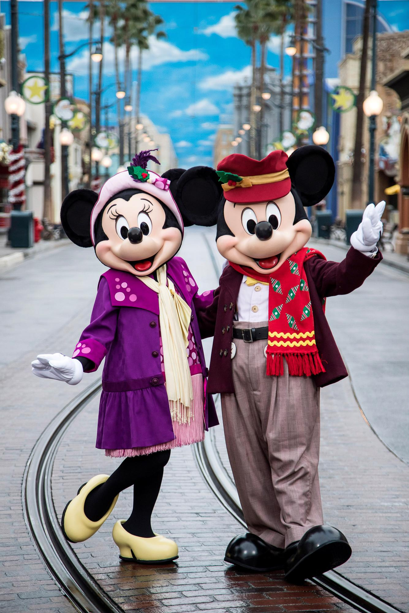 Minnie Mouse and Mickey Mouse dressed up for the holidays