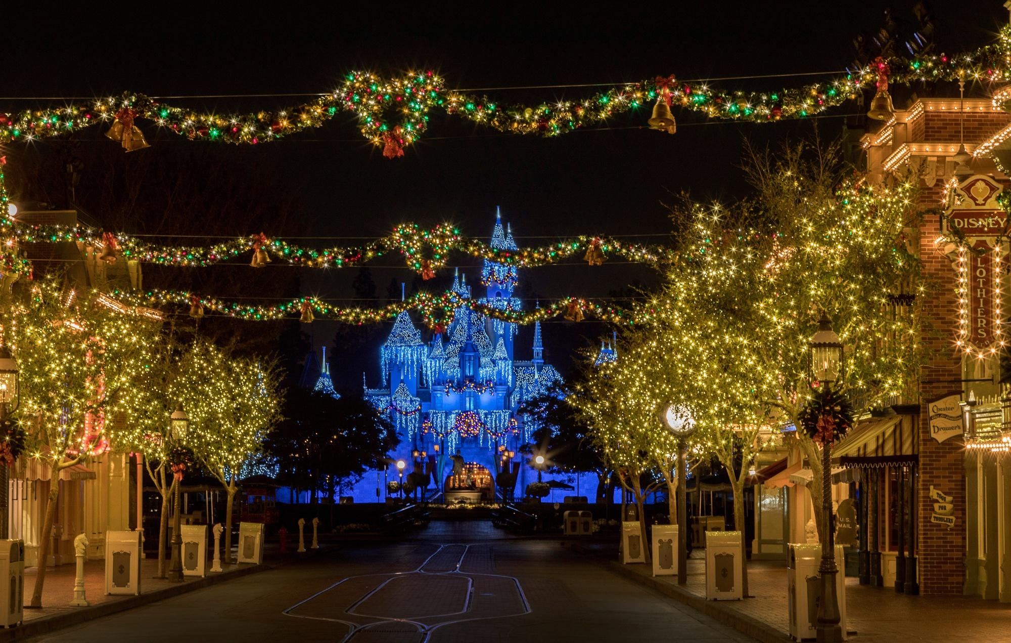 Disneyland holiday decorations on Main Street and Sleeping Beauty Castle