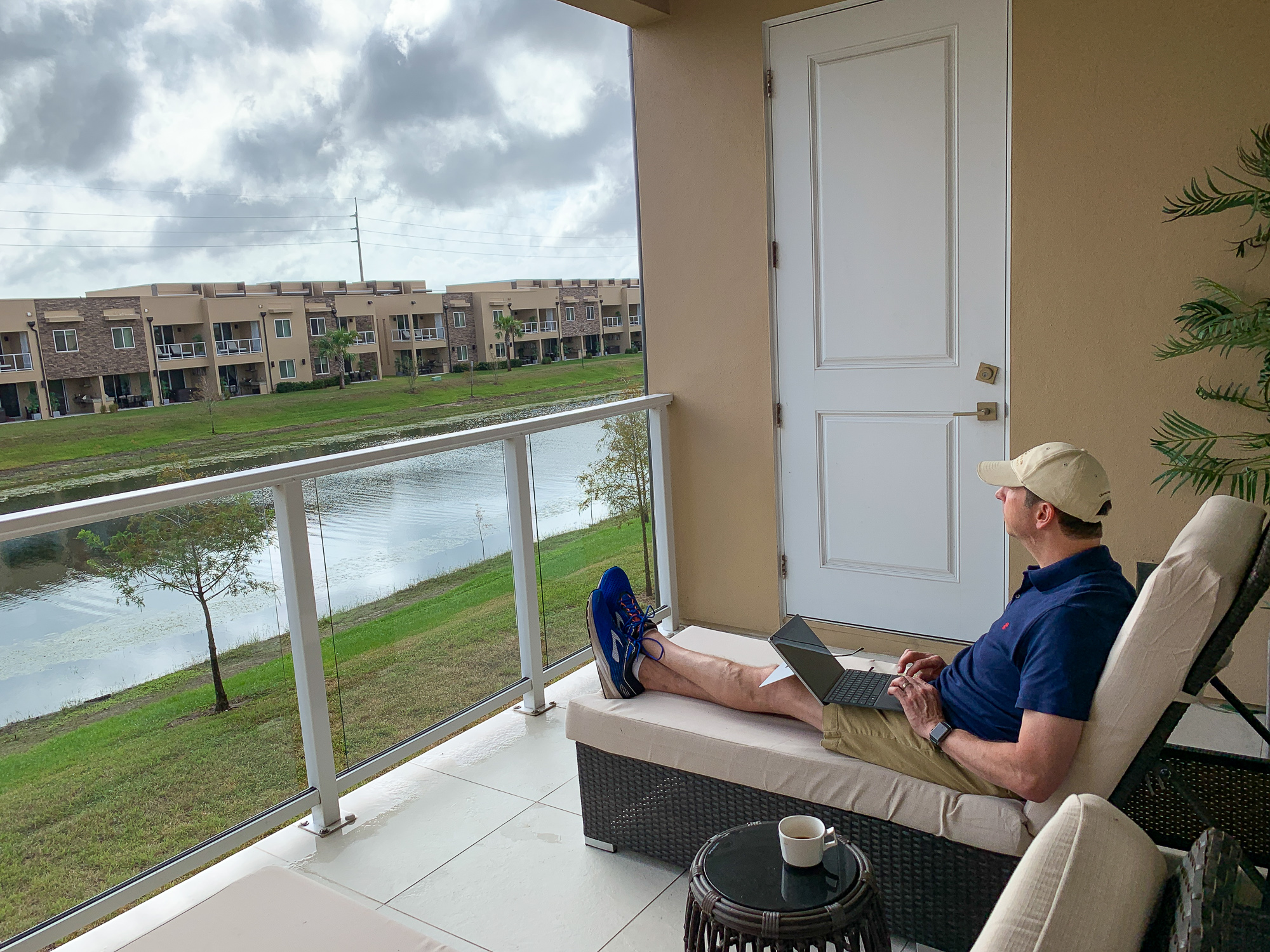 My husband relaxing on the balcony at our Magic Village vacation home