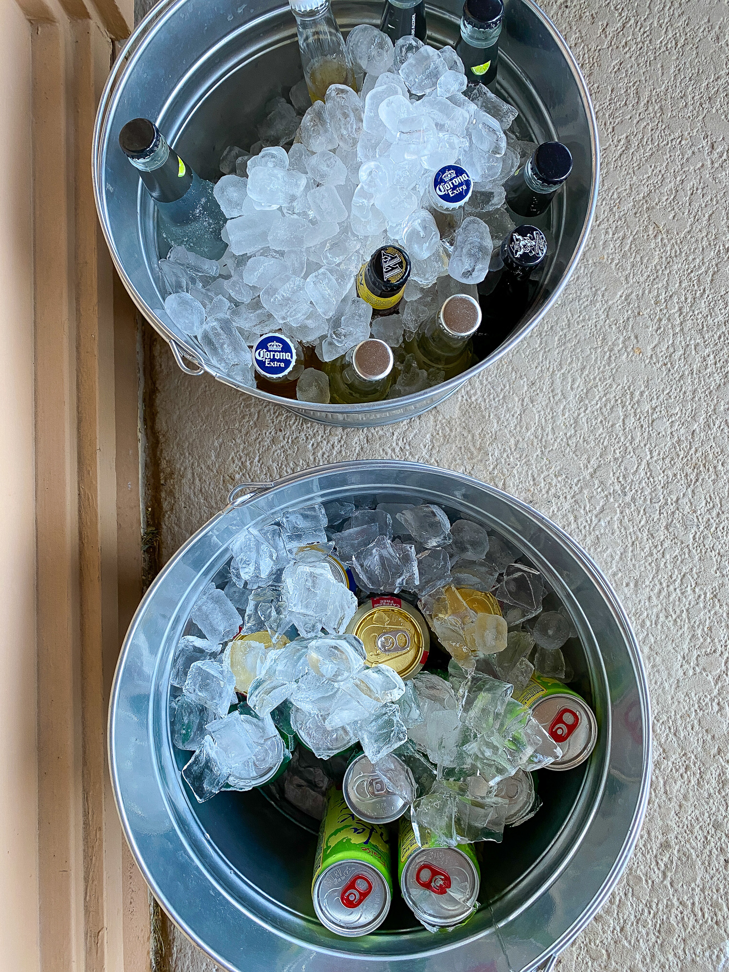 Serve one bucket of alcoholic beverages and one bucket of non-alcoholic drinks at your party