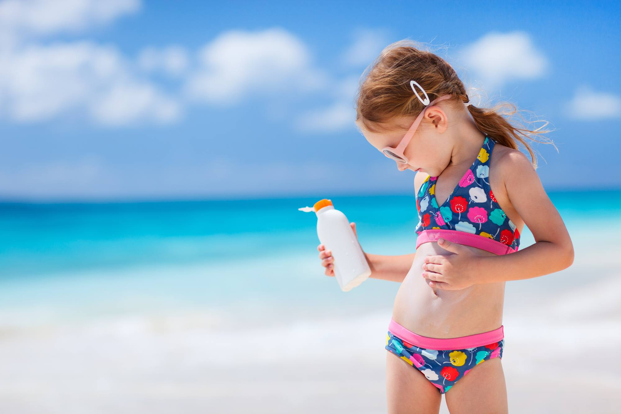 Apply sunscreen throughout the day at the beach