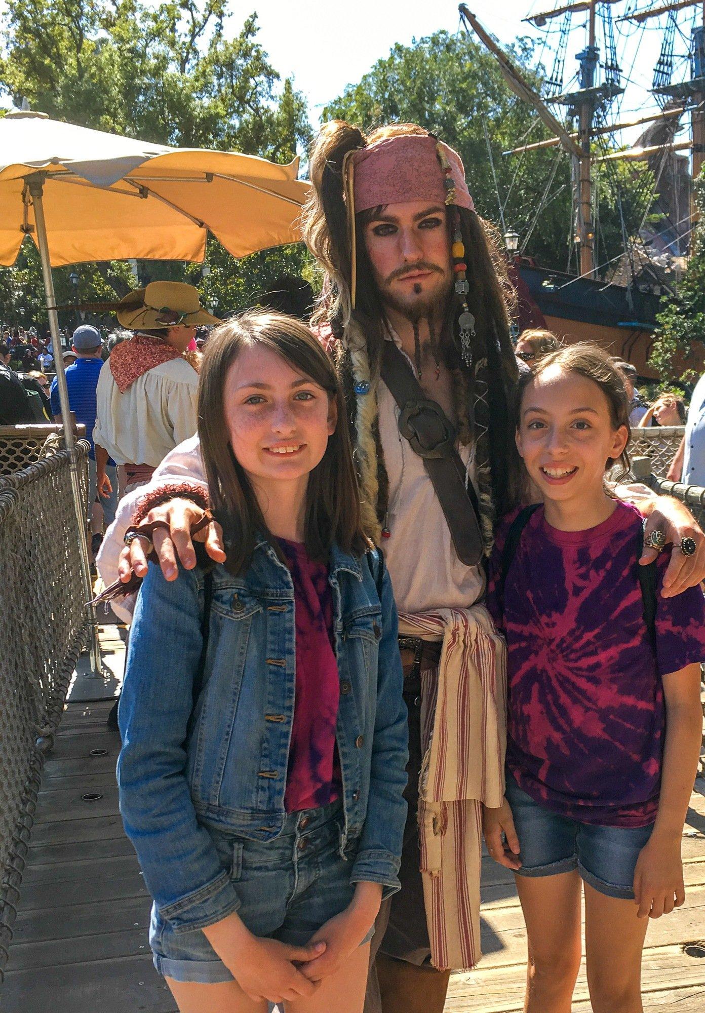 Teen girls with Captain Jack Sparrow at Disneyland