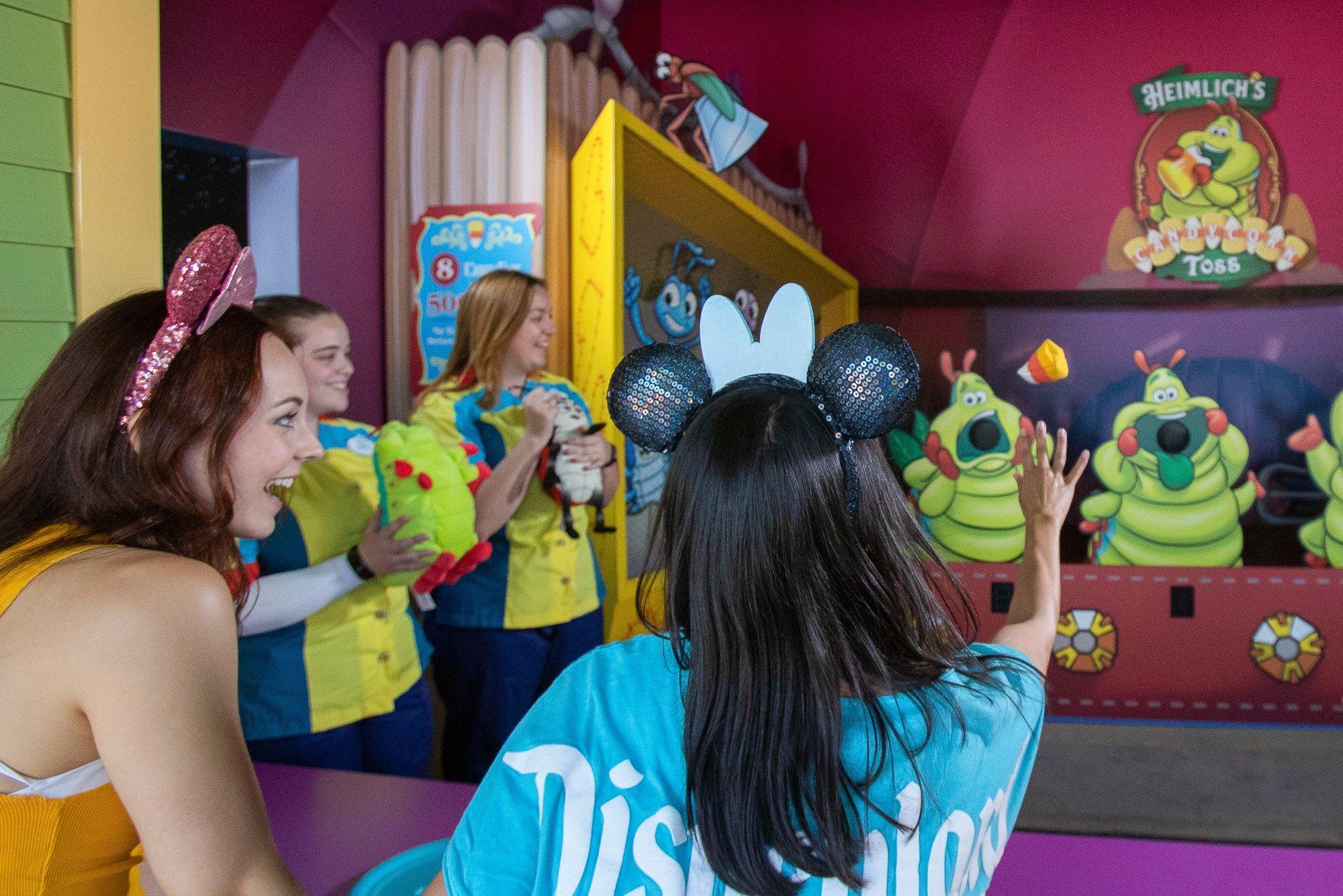 Teens playing Pixar Promenade Games at Disney California Adventure