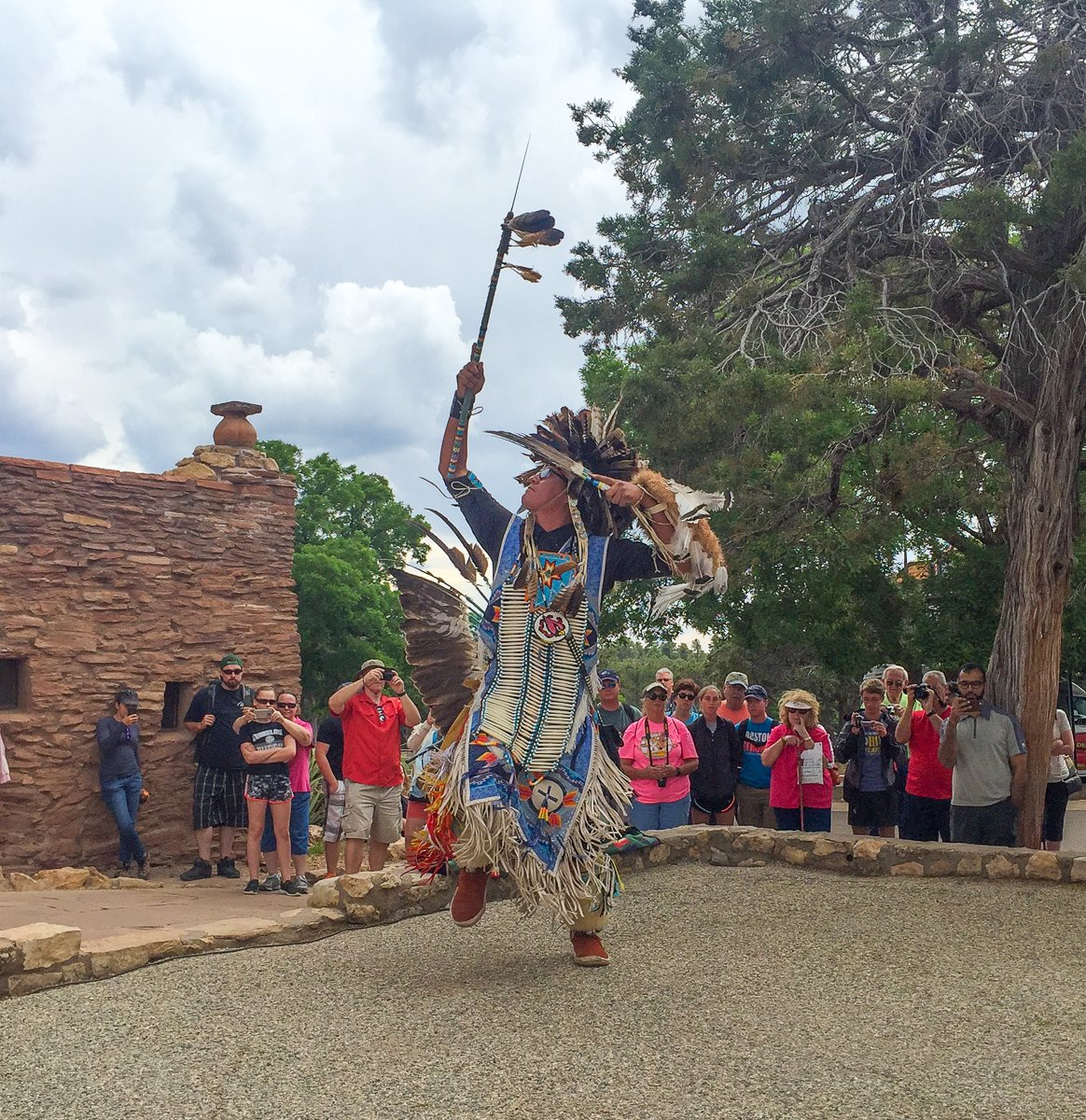 A Navajo troupe member performing a traditional dance near Hopi House at the South Rim of the Grand Canyon