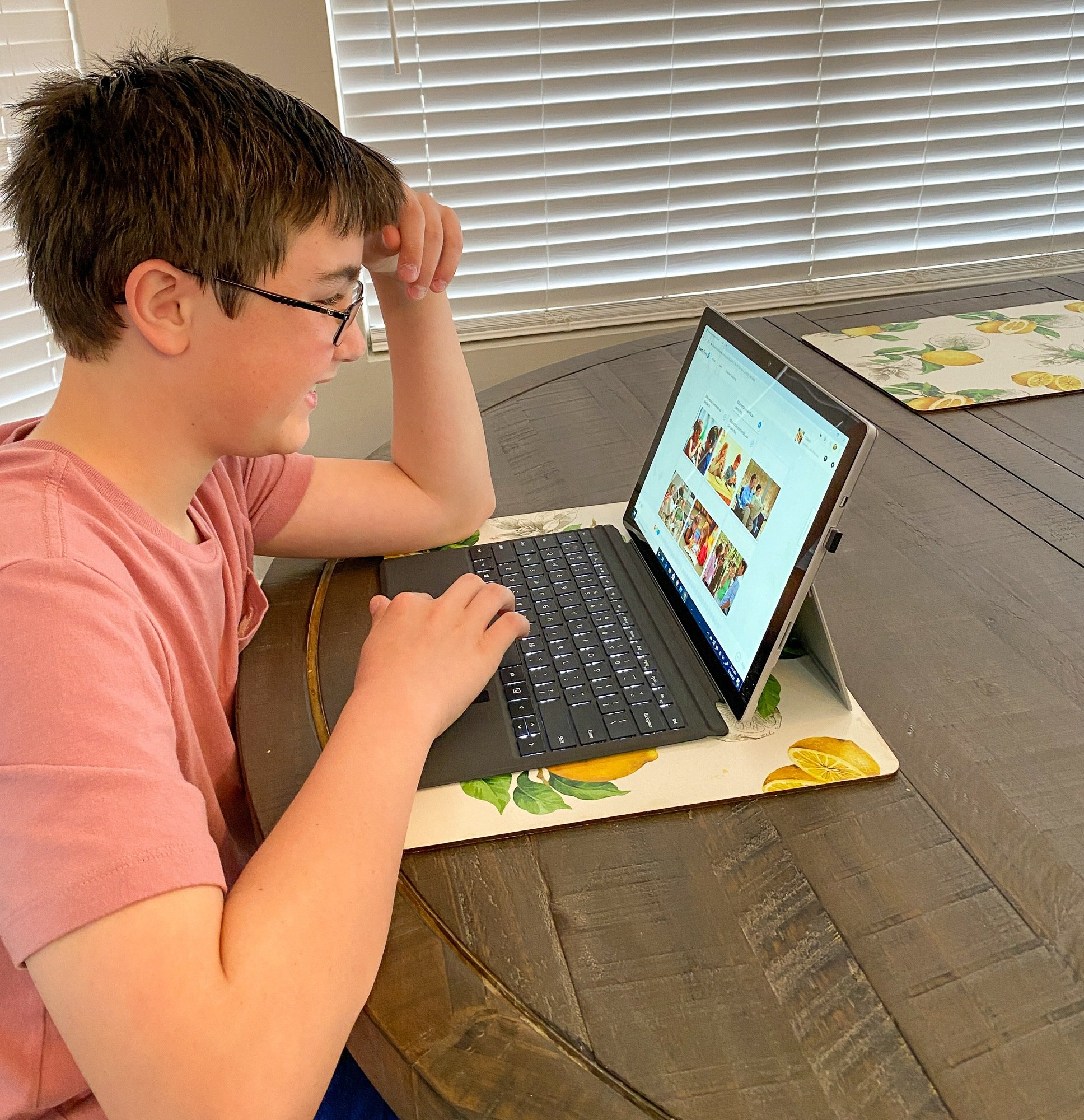 tween practicing his Spanish skills at home with Rosetta Stone