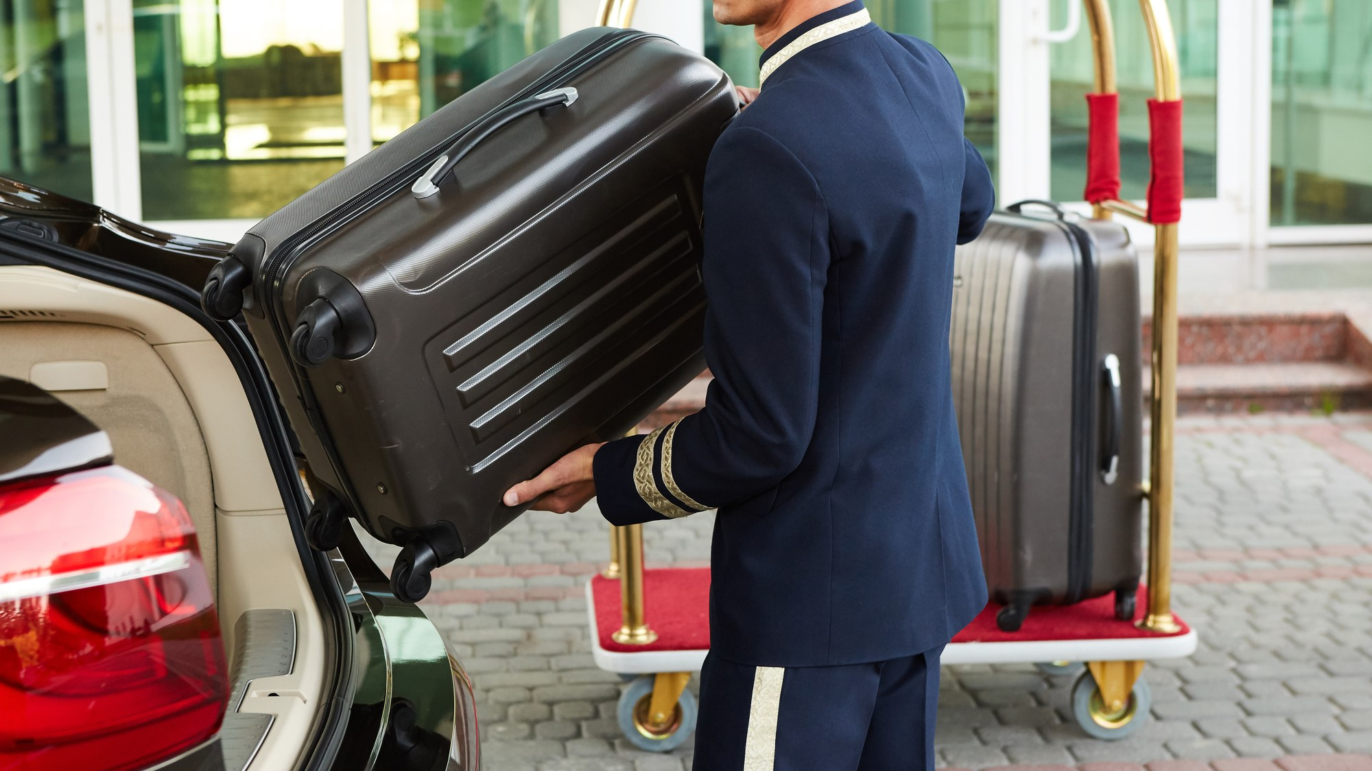 Bellman helping with luggage