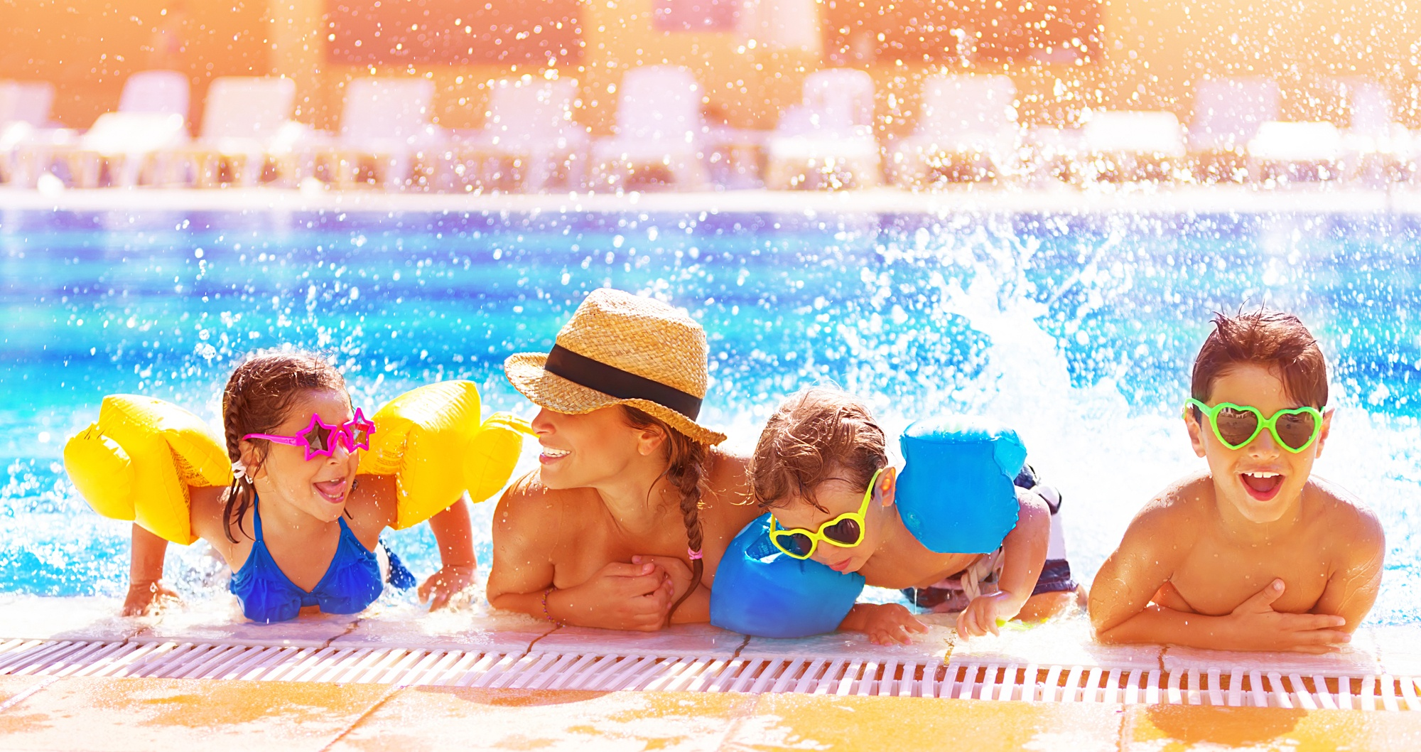 Single mom and kids at hotel pool