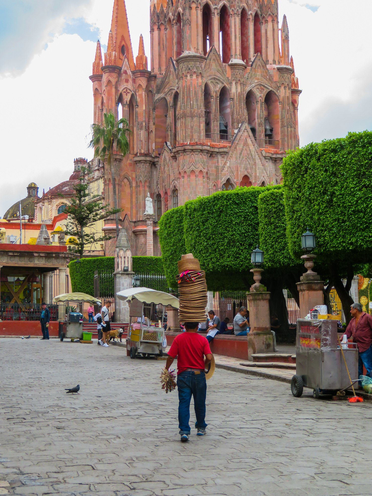 A hat vendor in San Miguel de Allende's central square