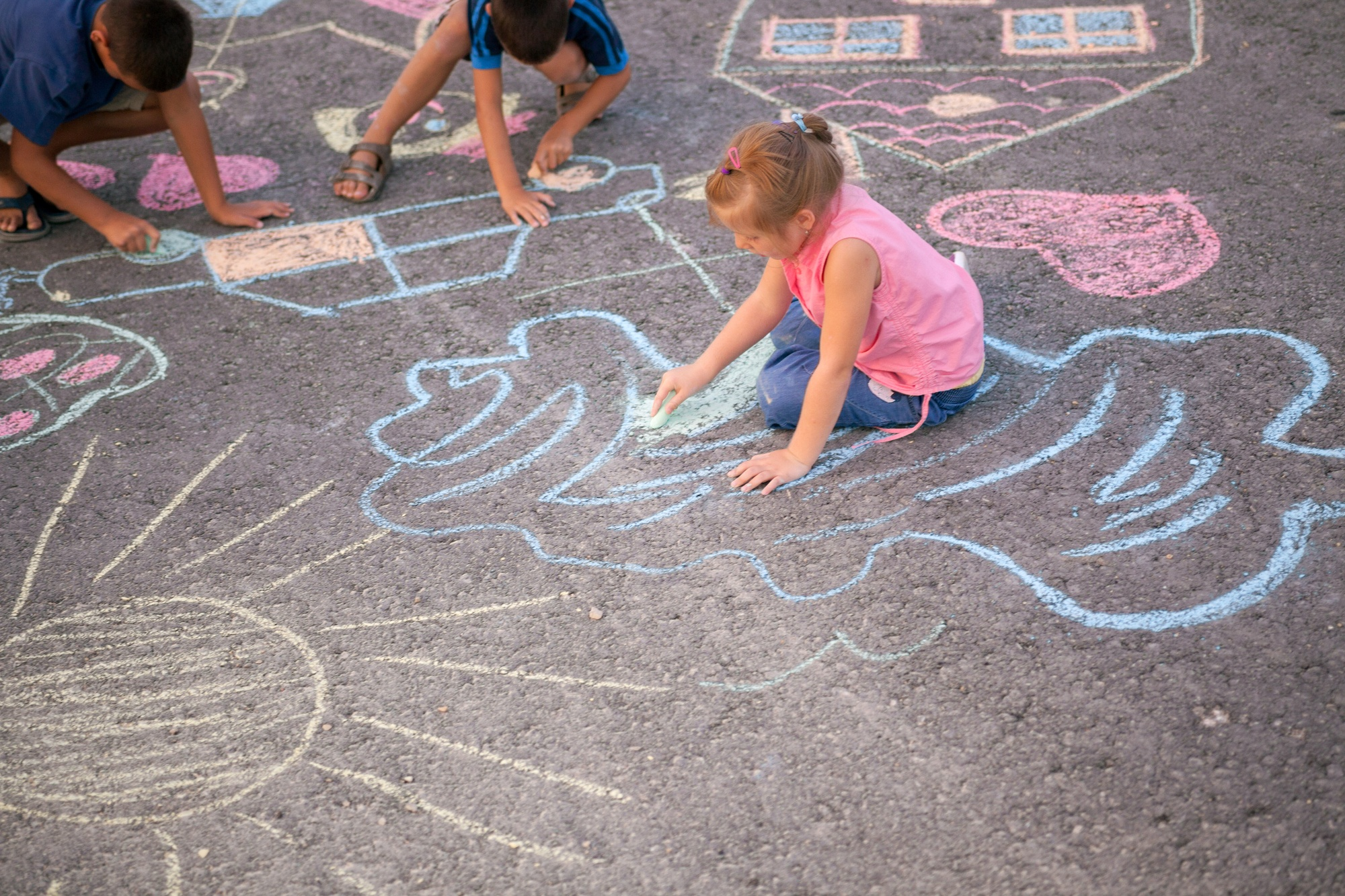 Children love drawing with sidewalk chalk