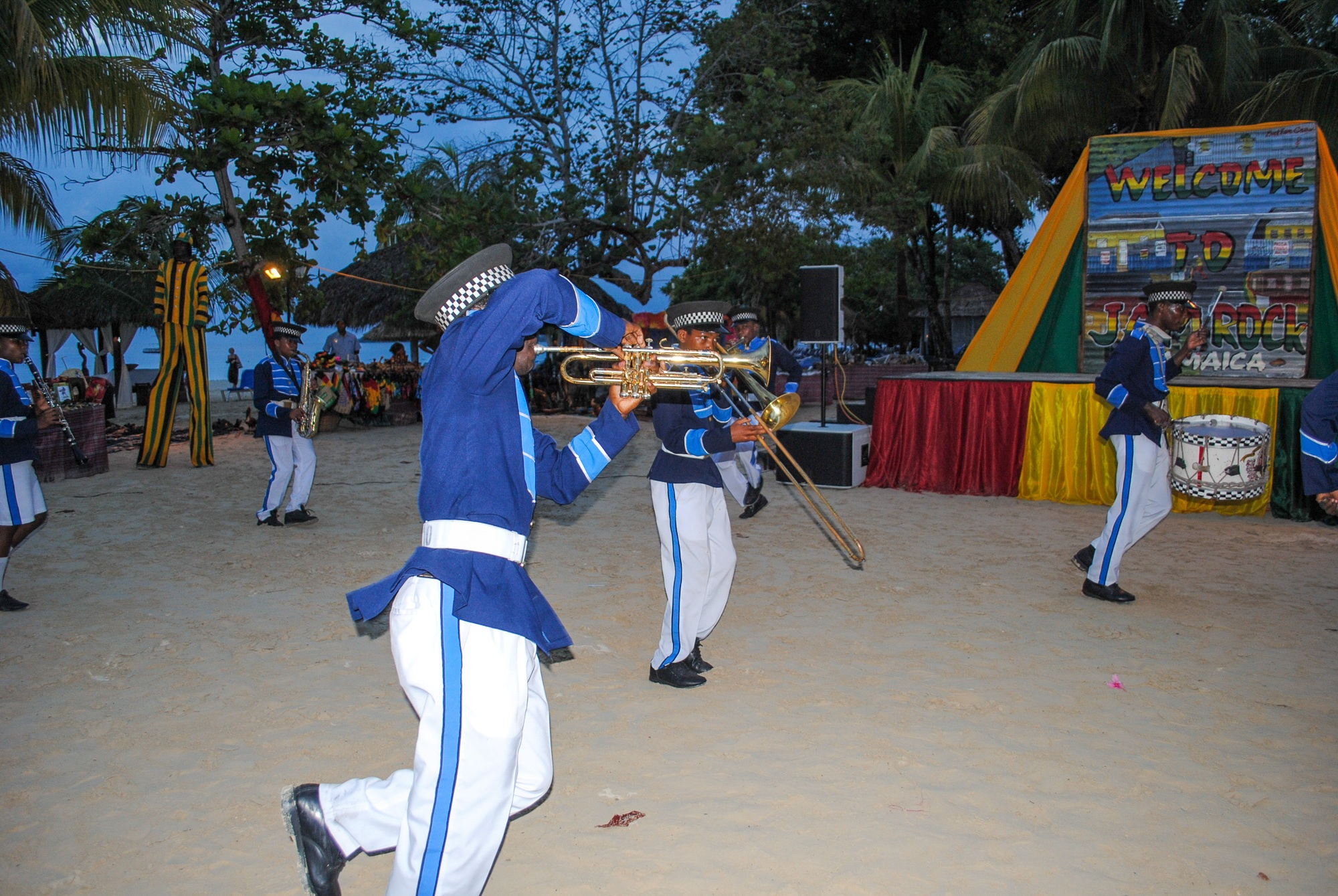 Local youth marching band performing on the sand in Jamaica