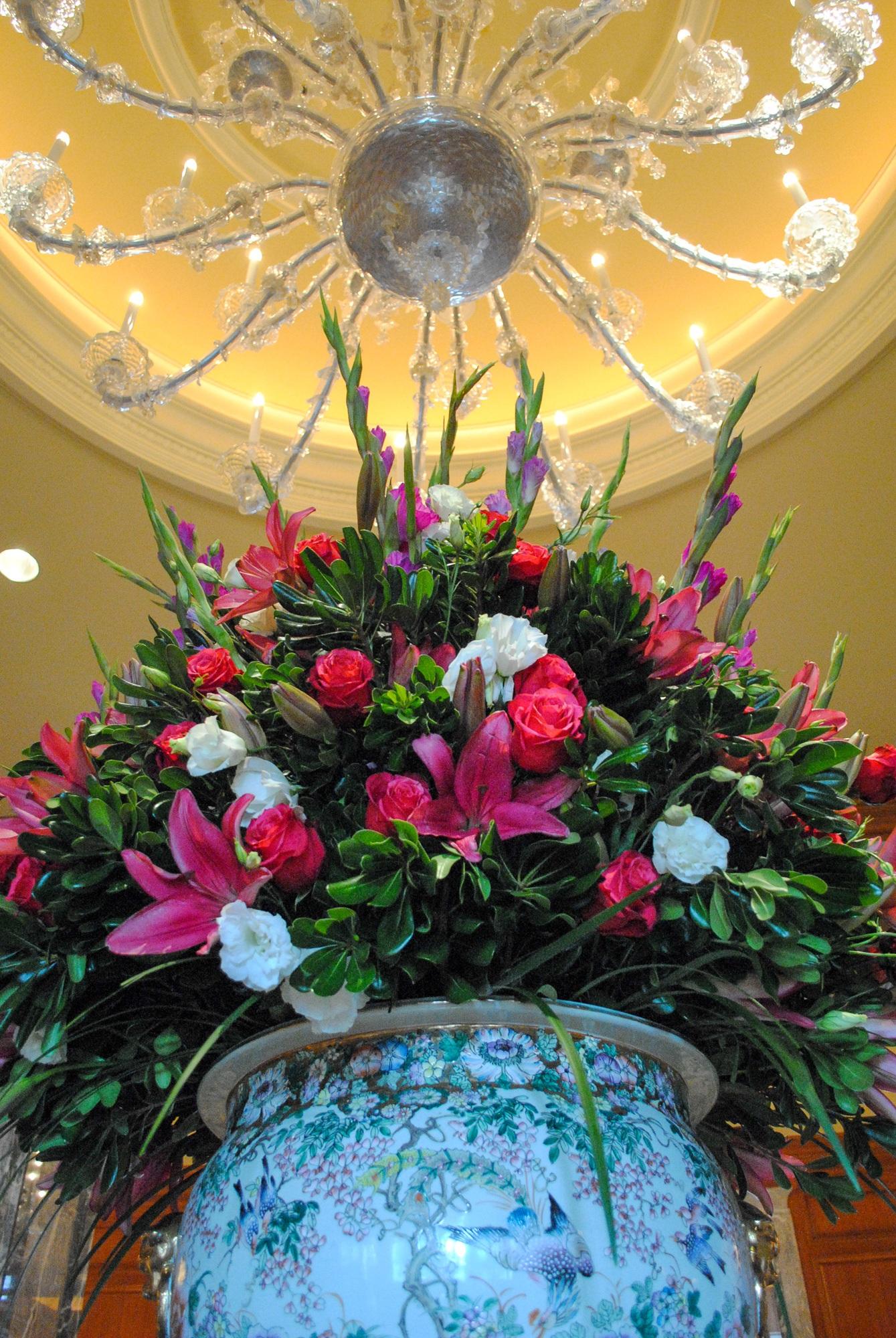 A beautiful flower arrangement below one of Grand America's many hand-blown chandeliers