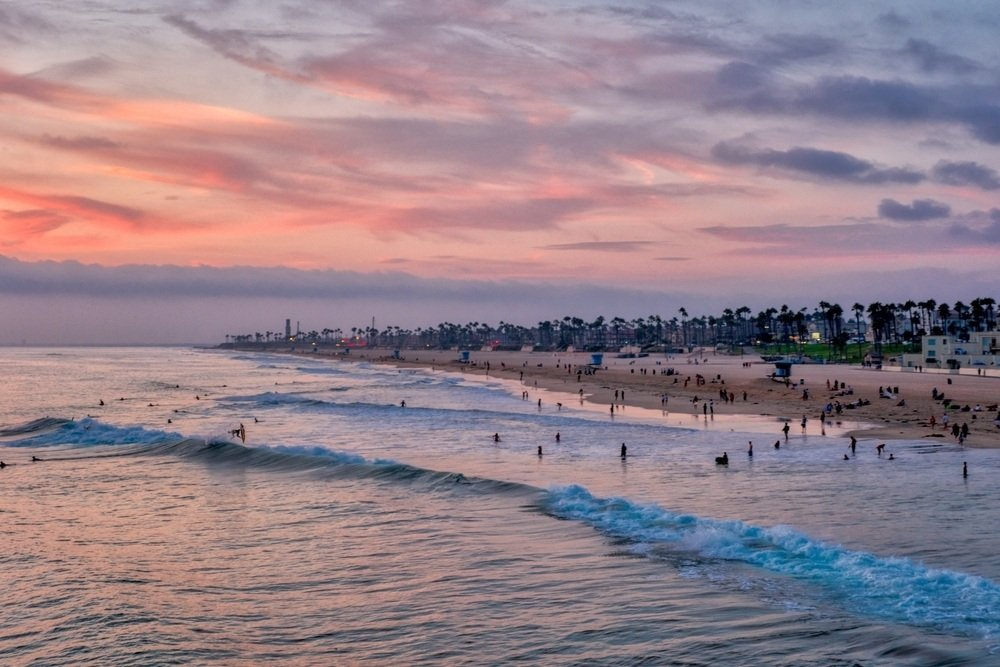 Surfers at sunset in Huntington Beach, CA