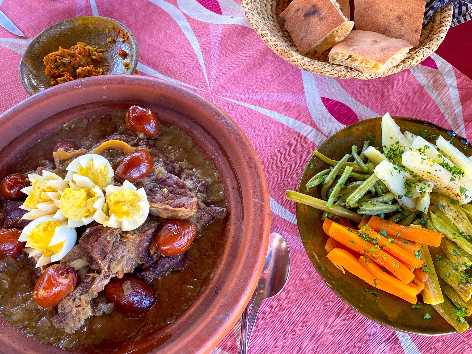 Camel tagine with a side of fresh veggies, harissa, and Morocco's true staple...bread