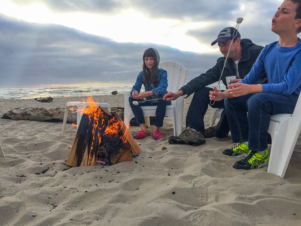 Roasting marshmallows for s'mores at Cannon Beach, Oregon Beach