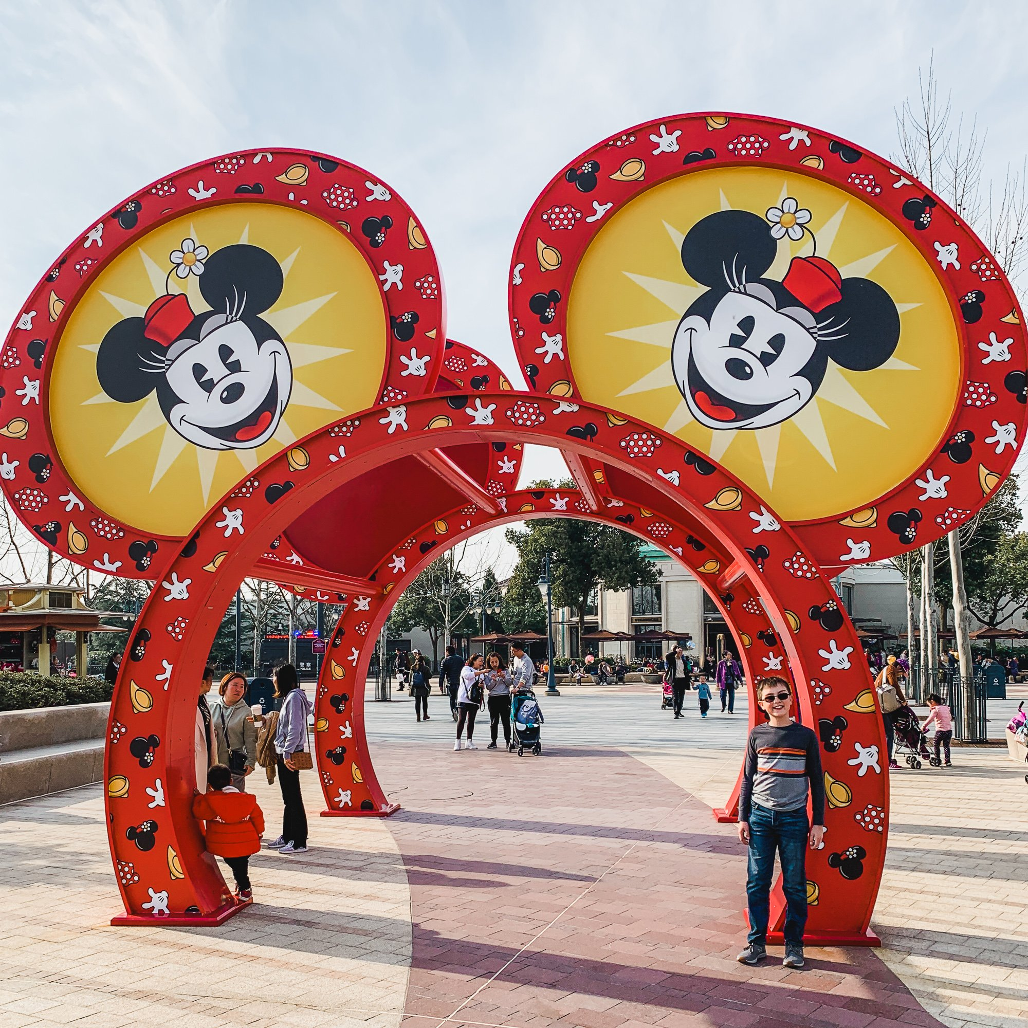 Young boy with Mickey Mouse arches in Shanghai Disneyland's Disneytown