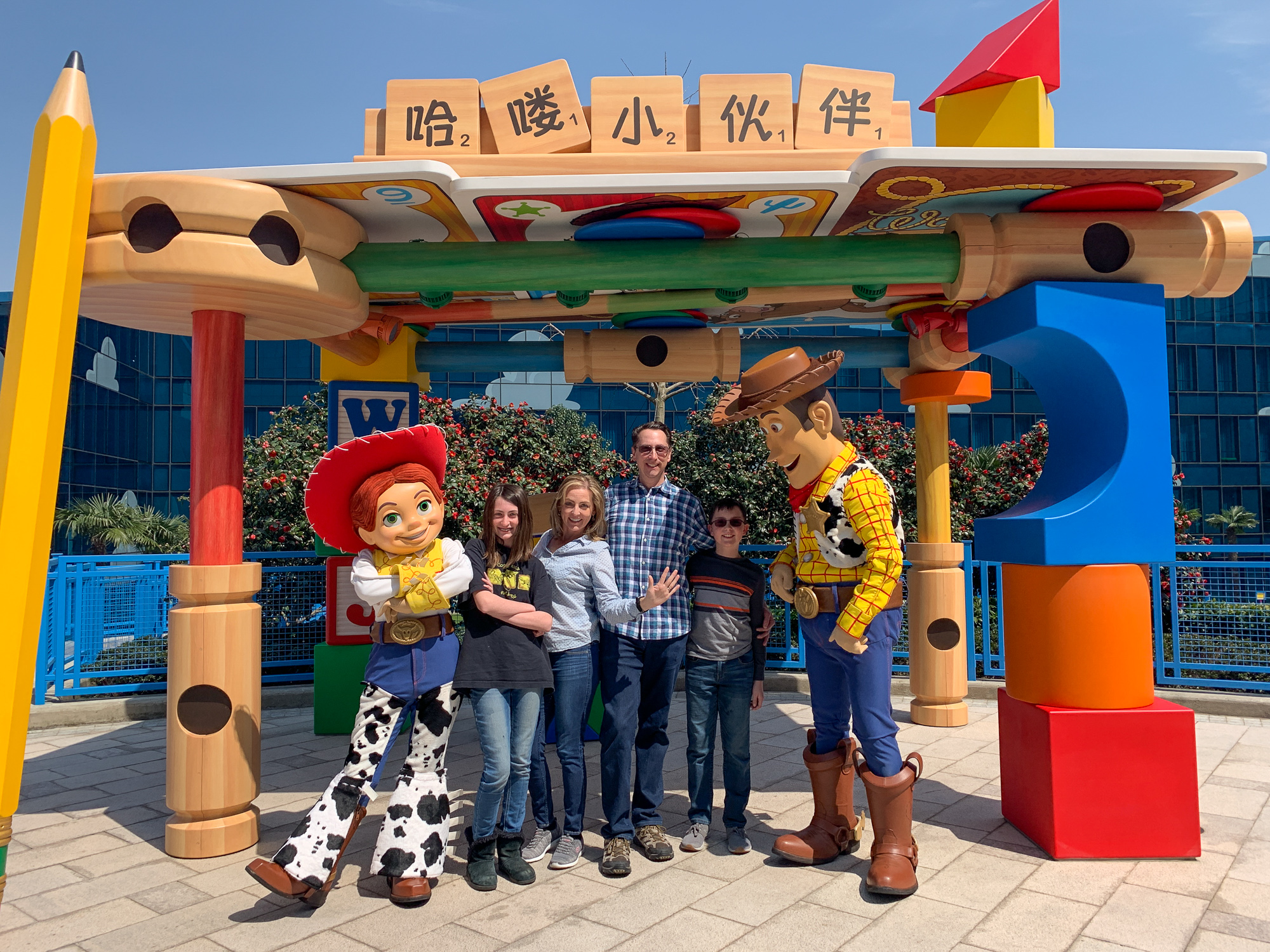 Family with Woody and Jessie at the Toy Story Hotel