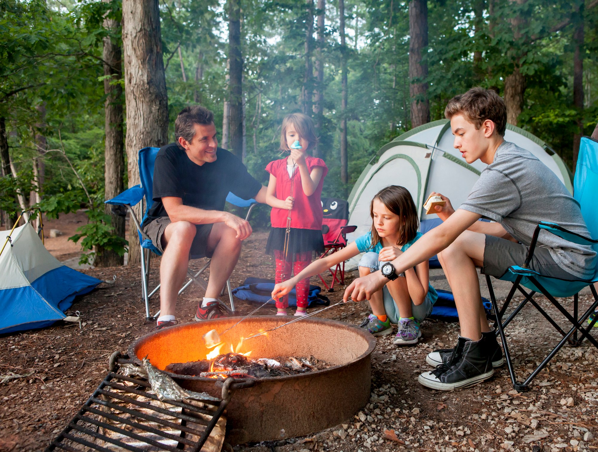 Dad and kids around a camp fire