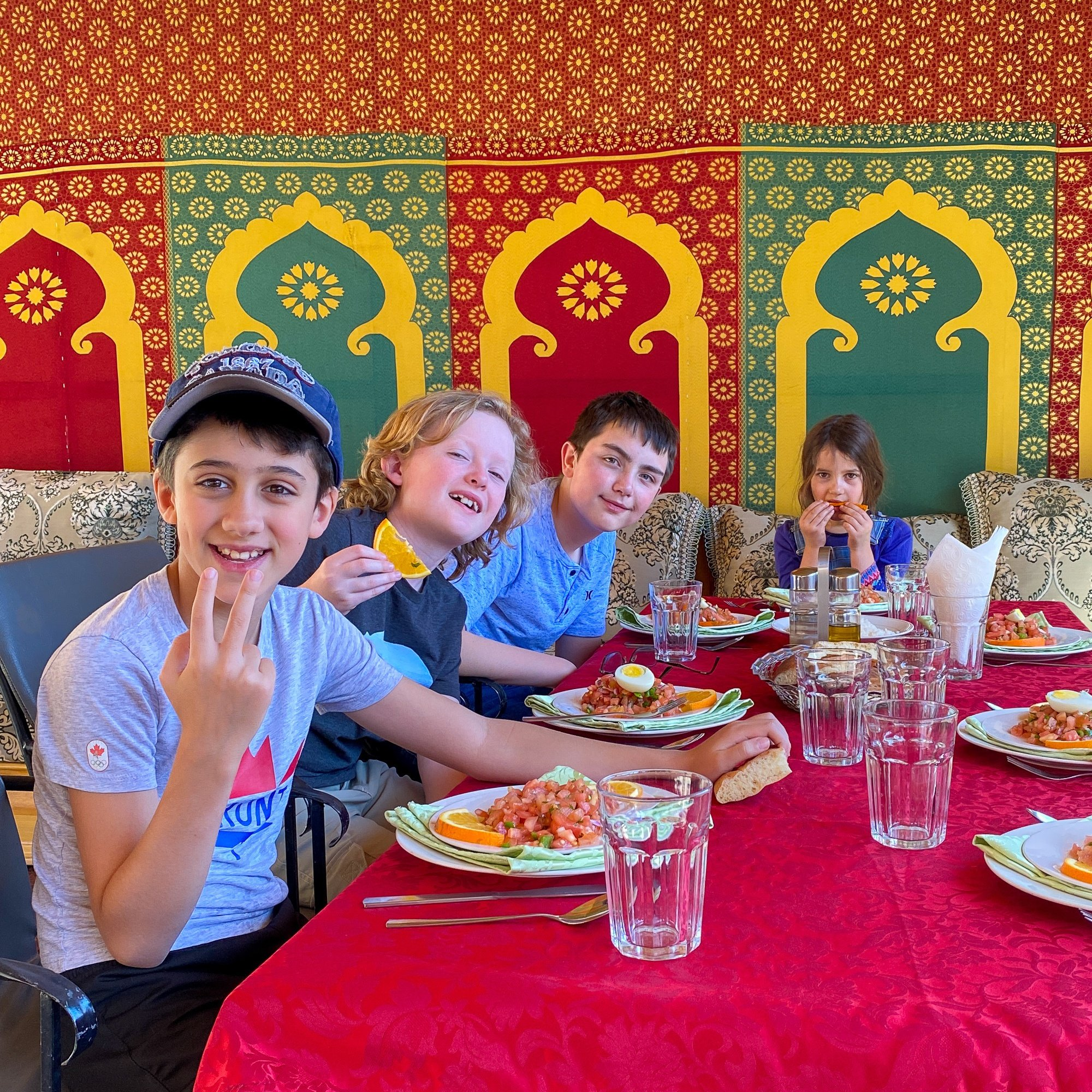 Kids dining together on our National Geographic Family Journeys and G Adventures tour